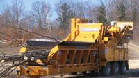 Horizontal grinder easily converts to a whole-tree chipping machine