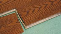 For fast flooring, install hardwood strips that have self-locking joints
