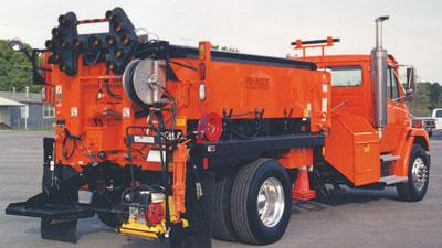 All-weather asphalt patching machine