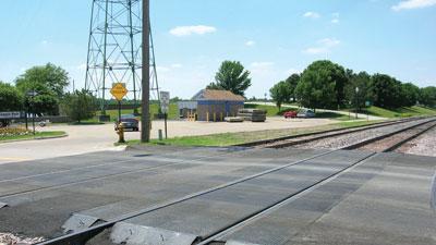 Railroad grade crossing surfaces