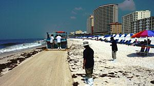 Beach Cleaning Machines Still At Work On Gulf Spill