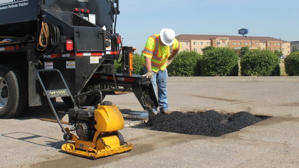 New York community combats potholes with patcher