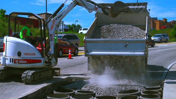 Chuckhole repair system uses waste tires to stabilize road base (with related video)