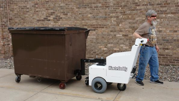 Tow device helps safely move dumpsters
