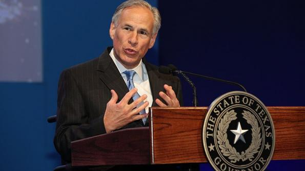 Texas governor signs immigration enforcement bill, gets mixed reaction
