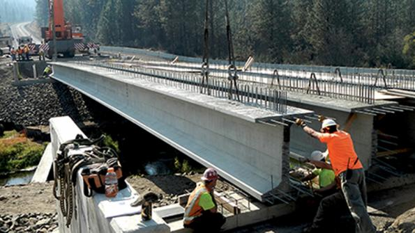 Concrete girders — sturdy and lengthy — used in Washington state bridge replacement