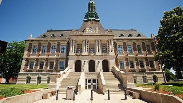 Police sue Nebraska city over health insurance changes