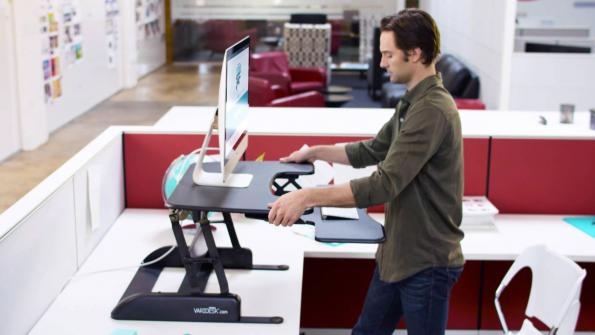 More government workers are using standing desks at the office (with related video)