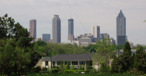 The Atlanta skyline with a green area in the foreground.
