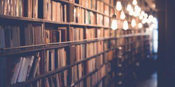 books on bookshelves and light bulbs