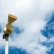 Old mechanical civil defense siren, also known as air-raid siren or tornado siren