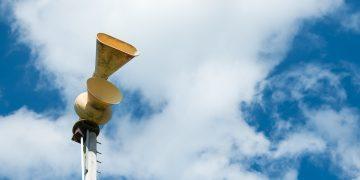 Old mechanical civil defense siren, also known as air-raid siren or tornado siren