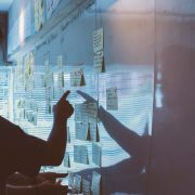 Man pointing to sticky notes in office as part of strategy