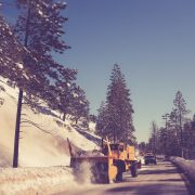 snowplow clearing a road in winter
