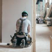 a man building a home