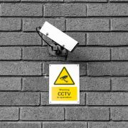 A video surveillance camera and sign warning about CCTV being in operation