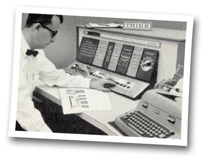 Photo of a scientific data-processing engineer in Detroit monitoring an IBM computer while it calculates in 1963.